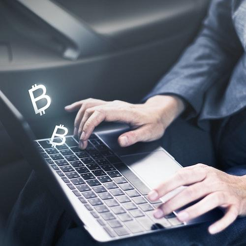 Cryptocurrency person on laptop